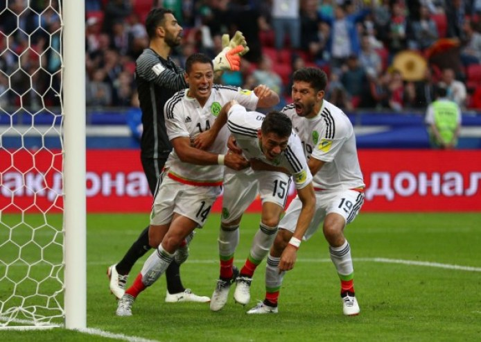 https://i1.wp.com/images.latinpost.com/data/thumbs/full/125975/600/0/0/0/chile-and-mexico-both-won-big-statement-games-in-the-leadup-to-the-2018-world-cup.jpg?resize=694%2C493