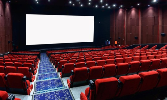 Indie Movie Theaters Smack Mark Cuban s Landmark Theatres With     Empty movie theater with red seats  SnvvSnvvSnvv Shutterstock com