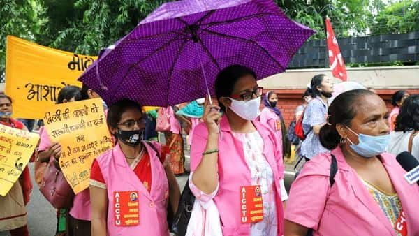 Accredited Social Health Activist workers speak to the media during a protest against the Central Government demanding an increase in salary at Mandi House, in New Delhi on Friday. (Amit Sharma)