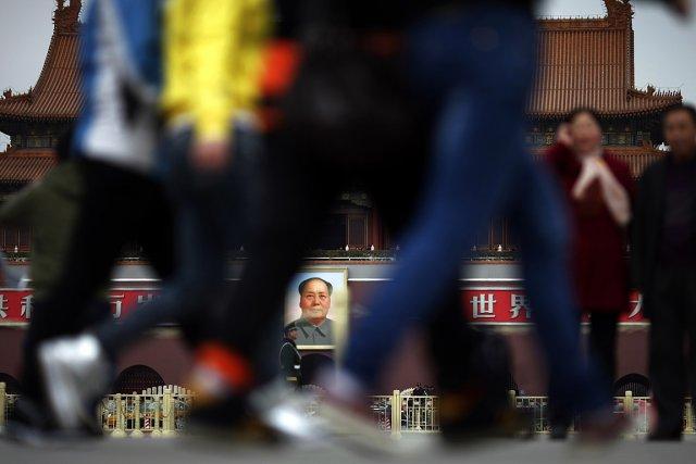 Scène de rue à Pékin où des gens... (Photo: archives Reuters)
