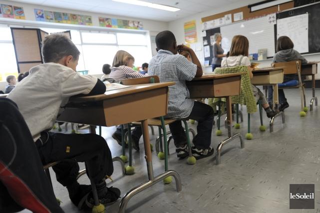 «Pour corriger les messages aux parents ou aux autres enseignants, j'utilise... (Photo Érick Labbé, archives Le Soleil)