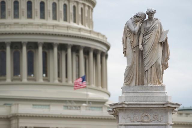 Le drapeau américain était en berne devant le... (PHOTO AFP)