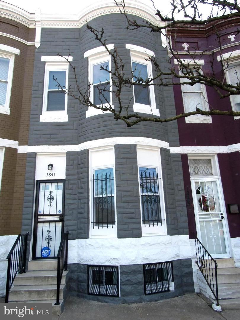 Photo of 1841 W MULBERRY ST, BALTIMORE, MD 21223 (MLS # MDBA541898)