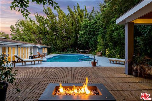 Photo of 18644 ROCOSO Place, Tarzana, CA 91356 (MLS # 19509410)