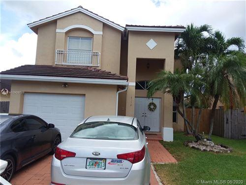 Photo of 14512 SW 155th Pl, Miami, FL 33196 (MLS # A10909788)
