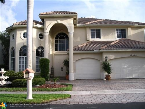 Photo of 12324 NW 26th St, Coral Springs, FL 33065 (MLS # F10216047)