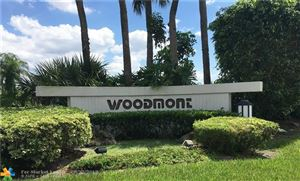 Photo of 7406 Woodmont Ter #106, Tamarac, FL 33321 (MLS # F10132152)