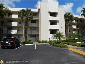 Photo of 2460 Deer Creek Country Club Blvd #106A, Deerfield Beach, FL 33442 (MLS # F10132231)