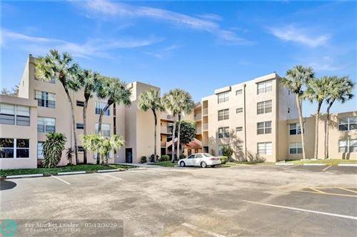 Photo of 9400 Live Oak Pl #107, Davie, FL 33324 (MLS # F10238397)