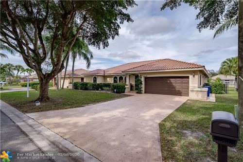 Photo of 6045 NW 56th Ct, Coral Springs, FL 33067 (MLS # F10215675)