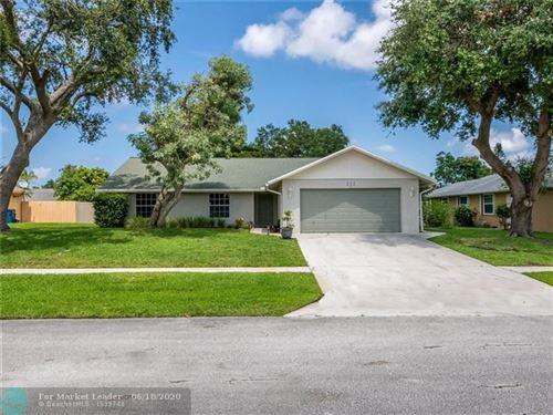 Photo of 111 Santa Cruz Ave, Royal Palm Beach, FL 33411 (MLS # F10231751)