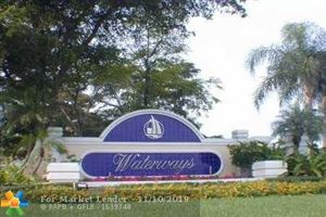 Photo of 1443 SW 48th Ter, Deerfield Beach, FL 33442 (MLS # F10202813)