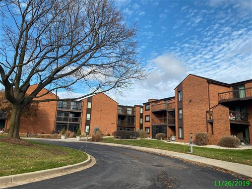 Photo of 6100 W STONEHEDGE DR #144, Greenfield, WI 53220 (MLS # 1675148)