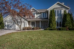 Photo of W147N7068 Woodland Dr, Menomonee Falls, WI 53051 (MLS # 1667386)