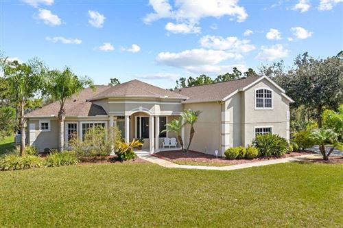 Photo of 14113 OAKWOOD COVE LANE, ORLANDO, FL 32832 (MLS # O5926037)