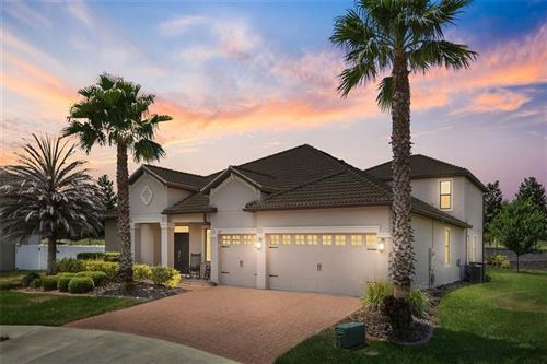 Photo of 1439 DEUCE CIRCLE, CHAMPIONS GATE, FL 33896 (MLS # O5942097)