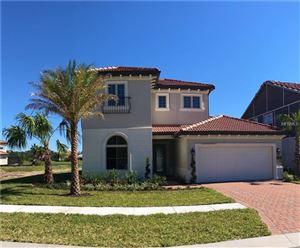 Photo of 10463 ROYAL CYPRESS WAY, ORLANDO, FL 32836 (MLS # O5544216)