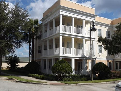 Photo of 7503 MOURNING DOVE CIRCLE #204, REUNION, FL 34747 (MLS # O5980254)