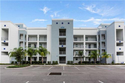 Photo of 4741 CLOCK TOWER DRIVE #305, KISSIMMEE, FL 34746 (MLS # O5893497)