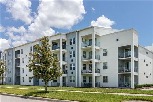 Photo of 4741 CLOCK TOWER DRIVE #202, KISSIMMEE, FL 34746 (MLS # S5037627)