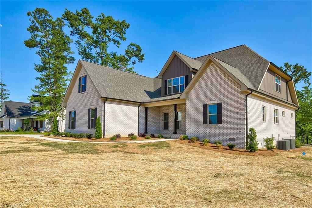 Photo of 7707 Honkers Hollow Court, Stokesdale, NC 27357 (MLS # 1009298)