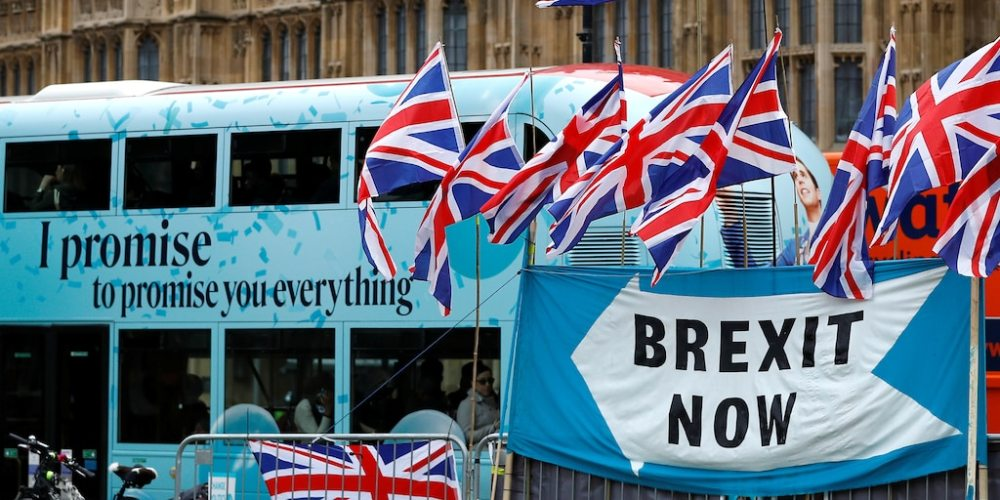 FILE PHOTO: A passenger bus passes a pro-Brexit demonstration in Westminster, London, Britain, September 30, 2019.  REUTERS/Peter Nicholls