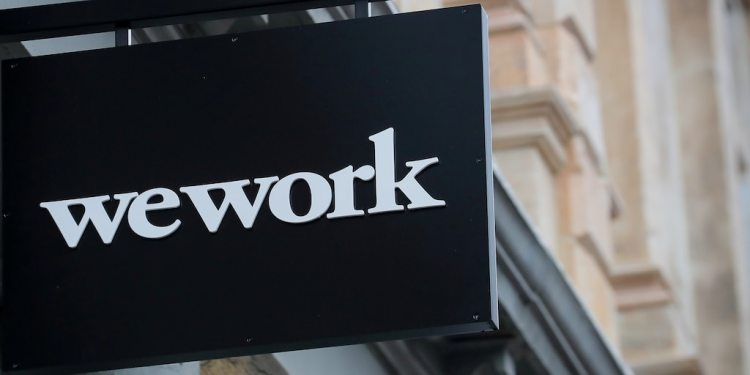 FILE PHOTO: The WeWork logo is displayed outside of a co-working space in New York City, New York U.S., January 8, 2019. REUTERS/Brendan McDermid/File Photo