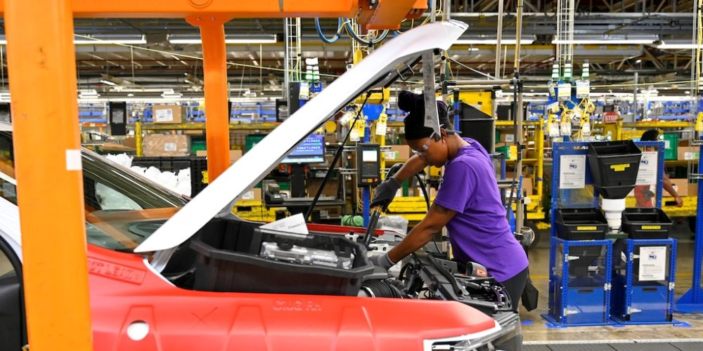 FILE PHOTO: Components are installed around the engine on the assembly line at the General Motors (GM) manufacturing plant in Spring Hill, Tennessee, U.S. August 22, 2019. REUTERS/Harrison McClary/File Photo