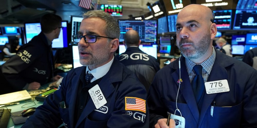 FILE PHOTO: Traders Anthony Rinaldi (L) and Federico DeMarco (R) work on the floor of the New York Stock Exchange (NYSE) in New York, U.S., January 28, 2020. REUTERS/Bryan R Smith