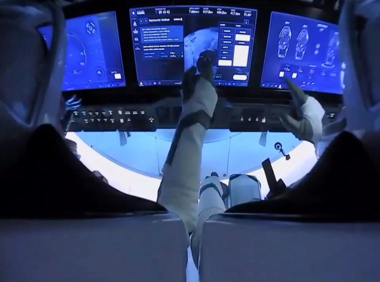 spacex crew dragon endeavour astronauts touch screen nasa astronauts bob behnken doug hurley