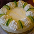 No Bake Lime Mousse Torte - This tart and tangy, no-bake cheesecake is flavored with white chocolate, lime juice, and gingersnap cookies. It is easy and can be made several days ahead. Decorate with dollops of whipped cream, raspberries, and fresh mint leaves, if desired.