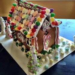Children's Gingerbread House Recipe and Video - This is one my mum in England used to make when we were kids. It was always the biggest hit every year. Use your imagination and a variety of candies to make doors, windows, pathways, and a garden. Note, this gingerbread house takes 2 to 3 days to complete. You can buy a variety of candies for decoration.