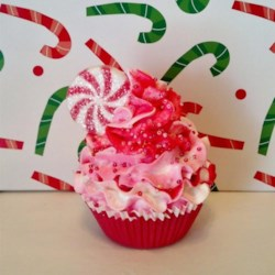 Pink Peppermint Cupcake Recipe - Peppermint cupcakes are topped with vanilla frosting and peppermint candies in these fun holiday cupcakes that are great for Christmas celebrations.