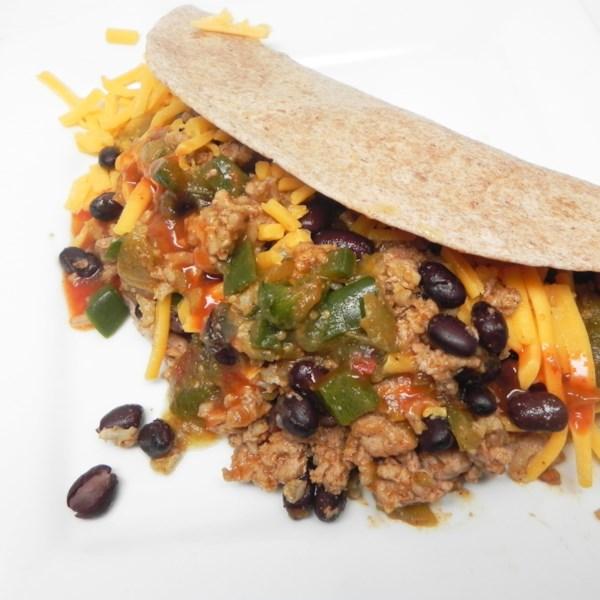 Receita mexicana de feijão preto e peru embrulha receita