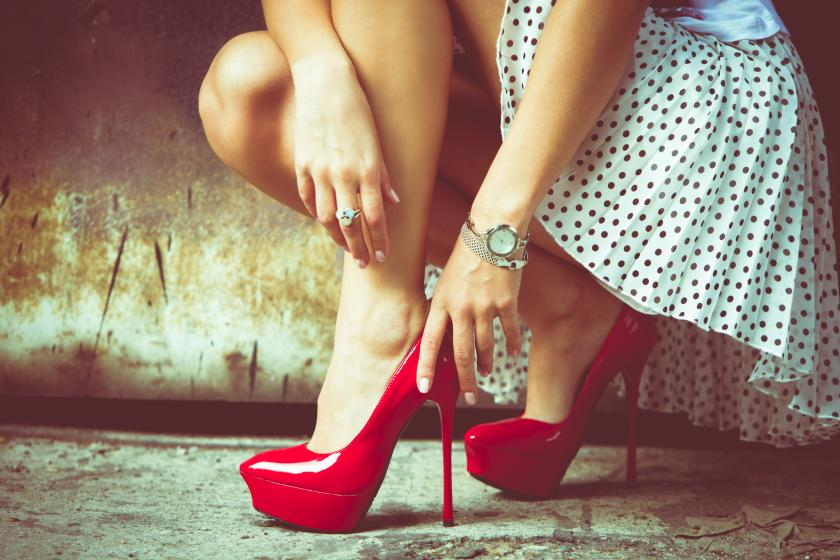 Woman in red high heels outside