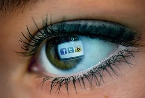 An eye reflecting a computer screen.