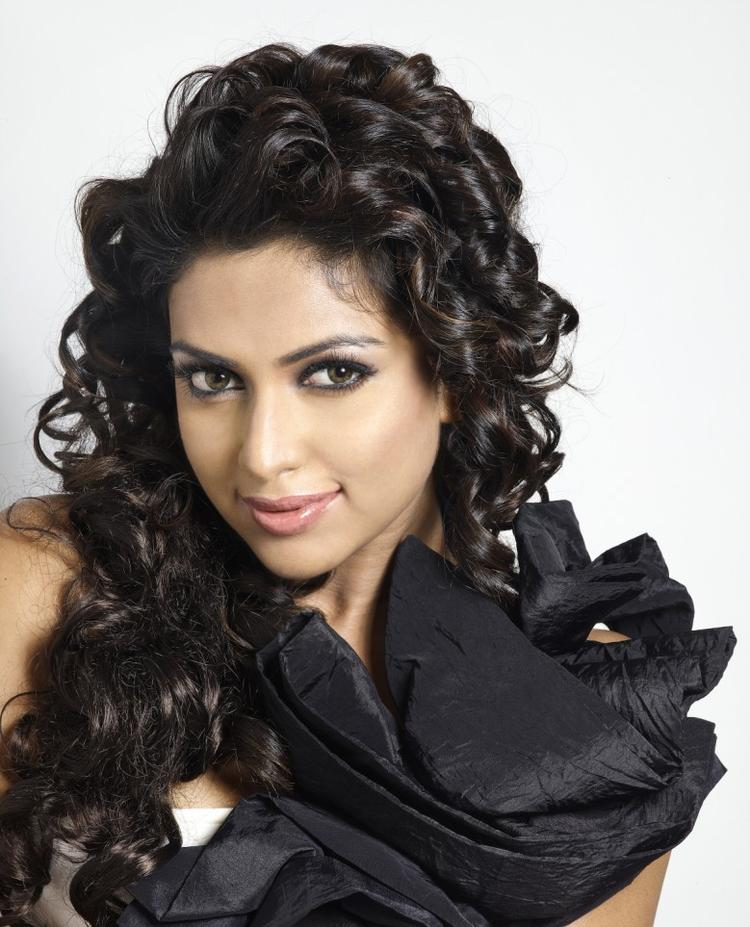 Amala Completed Her Look With Flowing Hair Still