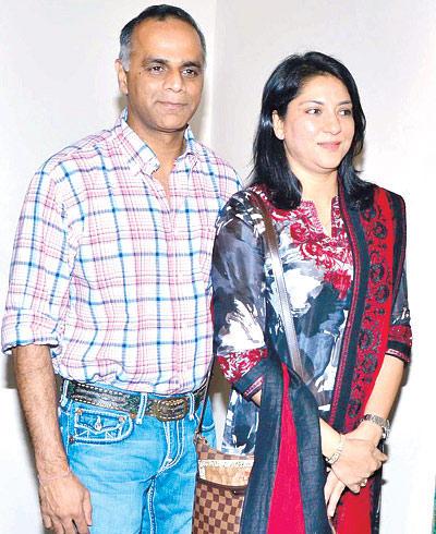 Owen Roncon And Priya Dutt Enjoy The Paintings At Devangana Kumar Art Exhibition