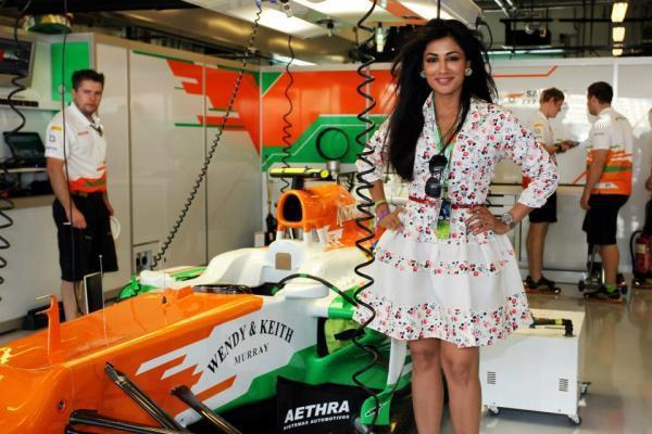 Chitrangda Trendy Looking Photo Still With Racing Car  At The Sahara Force India Pit Garage