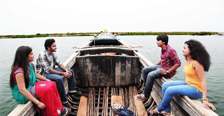 Geethanandh,Maithili,Krishna And Hasini On The Boat Still From Telisi Teliyaka Movie