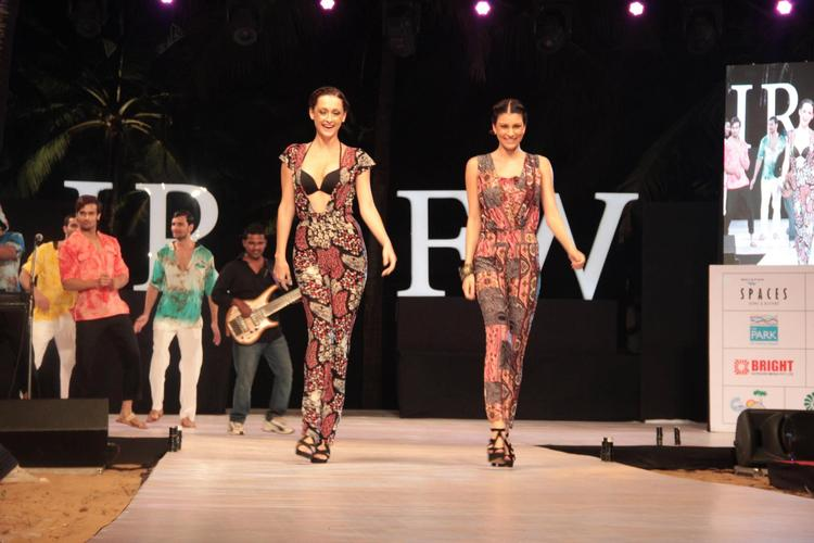 Two Models In Bronze And Gold Floor Length Gown On Ramp For Gogee Vasant At IRFW 2012