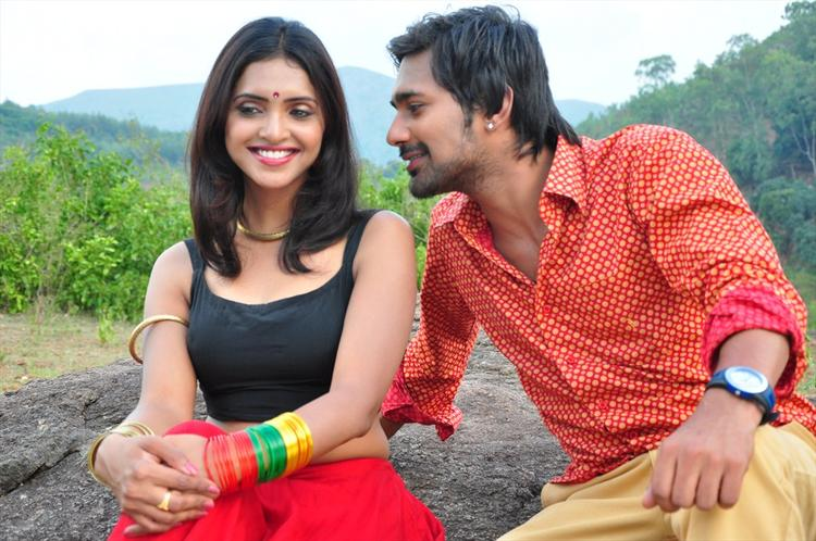 Varun And Sanchita Cute Smiling Still From Movie Chammak Challo