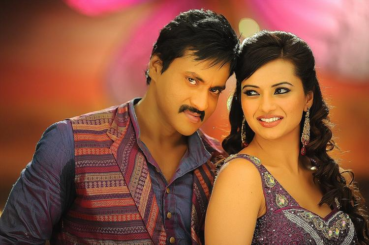 Sunil And Isha Sizzling And Dashing Still From Movie Mr Pellikoduku
