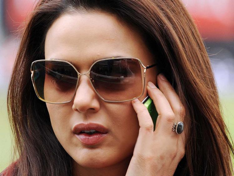 Preity Zinta Busy In Phone Pics