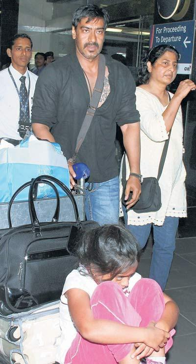 Ajay Devgan Hot Pic With Black Shirt and Jeans