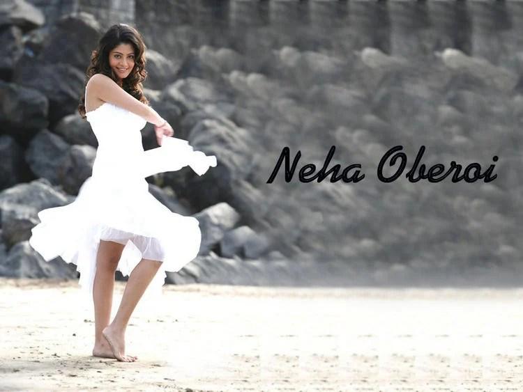 Glamour Neha Oberoi Sexy Dancing Pose Wallpaper