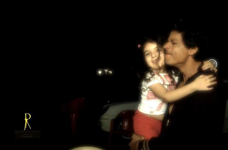 Shahrukh Khan With A Cute Child Smiling Photo Shoot For Dabboo Ratnani 2013 Calendar
