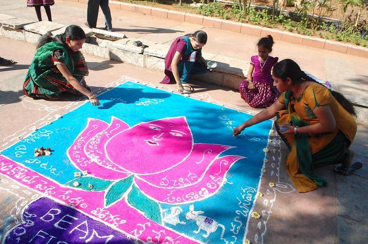 Girls Are Making Rangoli At Radio Mirchi Sankranthi Sambaralu 2013
