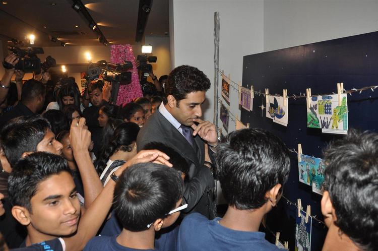 Abhishek With Childrens At Art Exhibition Of Radhika Goenka