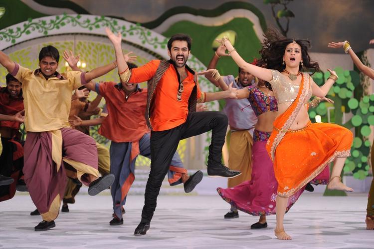 Ram And Kriti Dancing Still From Ongole Gittha Movie